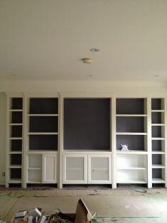 Built-in shelving to hide bulkhead in living room