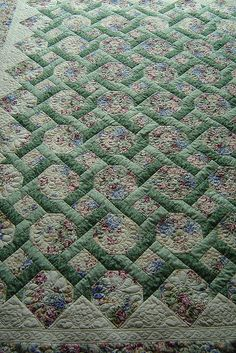 Lover's Knot Quilt.  Really hope to find a pattern for this one...it looks like a garden trellis and it could also be celtic knot work! (Jessica's Quilting Studio)