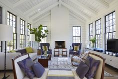 The family room features 15-foot vaulted ceilings and windows that look out over the new backyard pool.