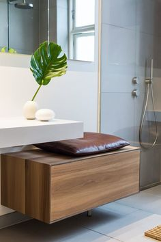 A broad drawer has been given a specially stitched leather cushion on top, so there is now a handy seat in the bathroom.