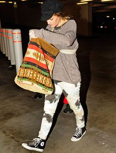 Pregnant Drew Barrymore covers up bump, wears super stretch jeggings.
