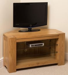 Kuba Solid Oak TV Corner Cabinet The Kuba Corner TV Cabinet is a stunning piece of furniture and a great addition to our popular Kuba range. Ideal for large TVs or smaller sets, this Kuba unit is not only beautiful but functional too. Oak Corner Tv Unit, Corner Tv Cabinets, Media Furniture, Furniture Price, Wooden Furniture, Floating Tv Unit, Living Room Tv Unit, Dresser Storage, Wood Glass