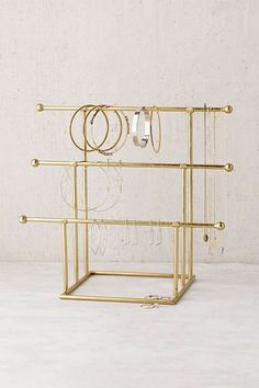 A tiered jewelry stand allows you to see everything your working with, so picking out your earrings when getting dressed is that much easier. Shop Our Pick: Urban Outfitters Emilia Tiered. stand 15 Earring Storage Ideas Your Jewelry Collection Needs