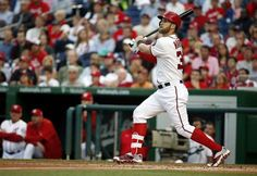 Washington Nationals' Bryce Harper watches his solo home run during the second inning of a baseball game against the Philadelphia Phillies at Nationals Park, Friday, May 22, 2015, in Washington. - © AP Photo/Alex Brandon