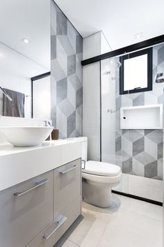 Looking to re-tile your kitchen or bathroom? Try a funky geometric tile! This falling block tile design is on-trend around the world. For more ways to add graphic pattern and punchy prints to your home, go to Domino. Bathroom Layout, Bathroom Interior Design, Modern Bathroom, Small Bathrooms, Bathroom Ideas, Bathroom Plants, Interior Ideas, Master Bathroom, Interior Inspiration