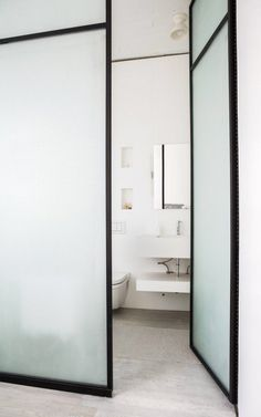 white bathroom interiors design via desire to inspire - Bathroom Doors Design