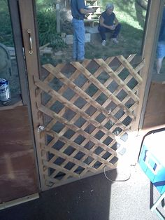 Old lattice plus screen door keeps the screen on, stiffens the door, and keeps dogs out.