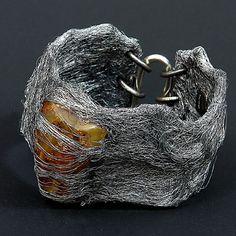 Paweł Kaczyński: untreated blocks of raw amber worked with silver, aluminum, and stainless steel