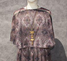 1970's sheer gypsy butterfly disco dress. $42.00, via Etsy.
