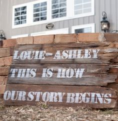 """This is how our story begins"" weathered wedding sign."