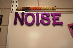 Take away a letter each time the noise level gets too high and when there are no letters left, there is NO talking.