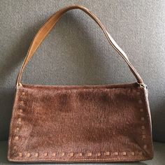"⚡️PRICE DROP⚡️Coach Pony Hair Hand Bag (RARE) Coach Pony Hair Handbag. No.DOJ-9470.  NEVER USED. RARE. Pony Hair. Medium Brown. Magnetic Popper Closure. Stitched Leather Trim. Leather strap. Fully lined brown fabric interior with one zippered pocket. Interior is clean and free of any stains.   Measurements: 11""(L)x5.5""(H)x2.75""(W) Strap Drop: 7.5"" Coach Bags Shoulder Bags"