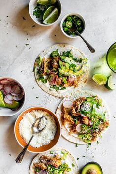 chipotle chicken tacos on tortillas on a light, white surface with toppings of avocado, cilantro, limes, cheese Burritos, Chipotle Chicken, Chicken Tacos, Roasted Chicken, Mexican Food Recipes, Dinner Recipes, Ethnic Recipes, Haitian Recipes, Holiday Recipes
