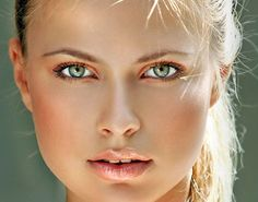 Use bright coral shadow and gloss to get this look.