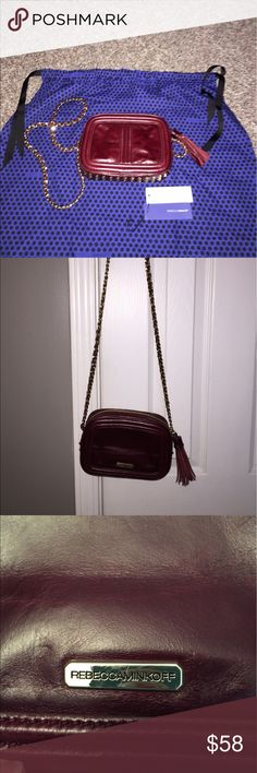 Rebecca Minkoff shoulder bag burgundy EUC! Stunning high quality Rebecca Minkoff statement shoulder bag with gold spike detail and woven chain straps. Zip around with blue polka dot lining. Excellent pre-owned condition used only a few times. Comes with RM blue polka dot dust cover. Absolutely gorgeous bag with high quality burgundy leather! Holds a phone, major, small wallet, all the essentials. Please ask any questions. Smoke free home. Clean. Rebecca Minkoff Bags Shoulder Bags