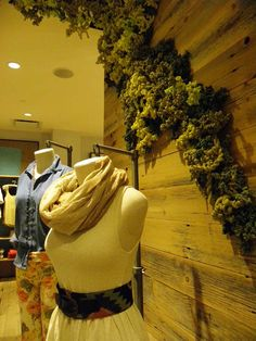 """Biophillia @Anthropologie - """"moss"""" crawling the walls made of rubber bands and plastic bags"""