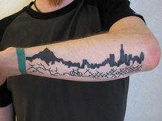 Cycling tattoo. Bricks and dirt roads