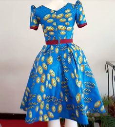Call, SMS or WhatsApp if you want this style, needs a skilled tailor to hire or you want to expand more on your fashion business. Short African Dresses, Ankara Short Gown Styles, African Print Dresses, African Print Fashion, African Fashion Dresses, African Attire, African Wear Designs, Ankara Designs, African Design