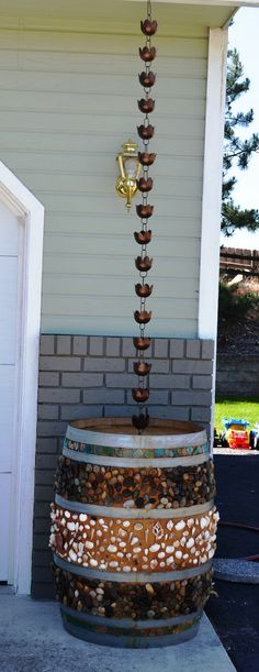 1000 images about rain barrel decorating ideas on for Rain barrel stand ideas