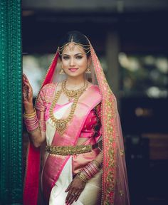 This bride sure knows how to turn heads! How gorgeous is her wedding day look! For some more wedding gorgeousness, head… Bridal Silk Saree, Saree Wedding, Silk Sarees, Indian Sarees, Indian Wedding Outfits, Bridal Outfits, Indian Weddings, Indian Wedding Couple Photography, Photography Couples