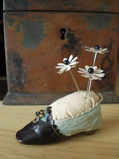antique shoe >>>>>> pin cushion  ( I have several antique baby shoes that I use as pin cushions) Got my first one over 25 years ago! ;-)