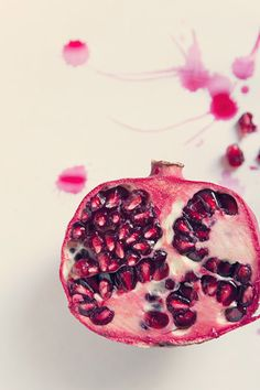 food photography red and white pomegranate by sandraarduiniphoto,