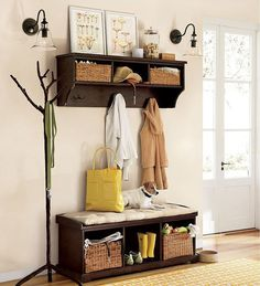 Parenthood has made us covet mudrooms. A spot for boots and all of our winter accoutrements would be fab, but our last condo's front door opened right into the living room and our current house only has a small foyer. We've managed to improvise with a mudroom-ish landing strip that has a spot for all of the essentials.