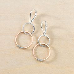 Can't get enough rose gold? Neither can we! We've taken a cue from our popular sytle of linked circles and mixed it up with silver and pink gold for this versatile and romantic pair of earrings. Each