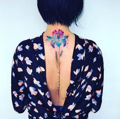 This flower watercolor tattoo is beyond beautiful.