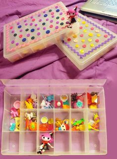 Lala fan Deanna Nova stores her Mini Lalaloopsies and accessories by dressing up a ($)2.50 craft organizer box from Wal-mart with some ribbon and buttons. Sew cute!