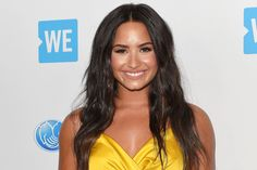 Demi Lovato shares an intimate moment with Cheat Codes singer Trevor Dahl while performing on stage. Female Songs, Gwyneth Paltrow, Dahl, Single Women, Demi Lovato, Celebrity News, Role Models, Wrap Dress, Singer