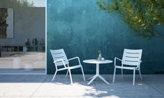 table | chairs | outdoor | indoor | white | cocktail table | lounge chairs | outdoor furniture | modern | in stock | sleek | simple | tables | restaurant | hotel | home | patio | porch | poolside | pool