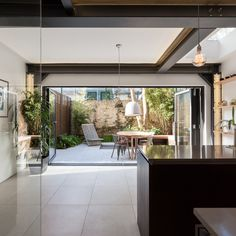 Kitchen and dining room with exposed steel bea. Kitchen and dining room with exposed steel beams. Photography by Peter Landers Open Plan Kitchen Living Room, Barn Kitchen, Dining Room, Kitchen Ideas, House Extension Design, House Design, Extension Ideas, Structural Steel Beams, Beam Structure