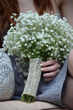 Burlap wedding bouquet - love the simplicity of the gypsophila and the finishing touch of we 'over here' call jute and lovely pearl pins...less is always more... :)