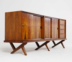 1stdibs | Rare Walnut Credenza with Crossed Leg Base by Fristho