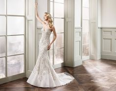 Eddy K. Couture CT160: Strapless sweetheart neckline, fit-n-flare, symmetrical embroidered heavy beaded tulle wedding gown. Available in Ivory-Silver