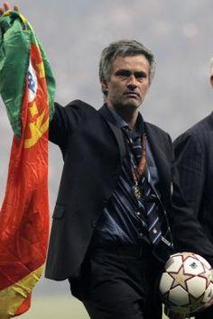 Mourinho holding a portuguese flag