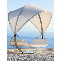 Royal Botania gets into the swing of things with Surf. Measuring 11-feet-by-11 feet, the hammock features a full fabric canopy that blocks more than 80 percent of the sun's rays while remaining semi-transparent.