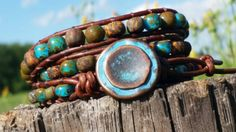 This time, a vibrant splash of turquoise wakes up the earthy matte picasso glass Czech beads in this rustic leather triple wrap bracelet. The leather Is fabulously soft supple and distressed. it will wrap around your wrist three times. An extra loop is available of you want a little extra room.  These aged czech matte rustic beads are becoming relics....my stash is rapidly declining. The small factories are not producing these fabulous beads anymore. So get em while you can