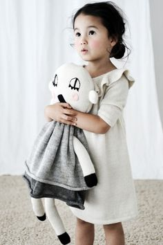 Sweet little girl in adorable knitted dress