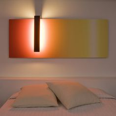 Corso Wall Sconce - whose lighting arm runs from left to right, like a scanner of vertical light on a color degradations background, made of a gently reflective material. The light source is not included; the lamp takes two T5 Fluorescent tubes 55 W.  http://www.switchmodern.com/Wall-and-Ceiling-Lamps/Santa-and-Cole-Corso-Wall-Sconce.asp