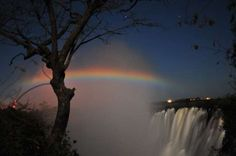 VICTORIA FALLS, ZAMBIA Forming the border of Zambia and Zimbabwe, the Victoria Falls are nature at its most primal. If you're lucky enough, you may see the lunar rainbows that occur between April and August for three days around the full moon.  MichiV/Getty Images