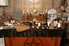 Samhain - death themed altar; you can see my ancestors images there in the bottom right corner along with the Correllium to represent my tradition ancestors. Decor includes turned leaves from my yard, gourds, pumpkins, maize and Halloweeny items. That little tree to the left has hand made salt-dough ornaments too! #wiccan #pagan
