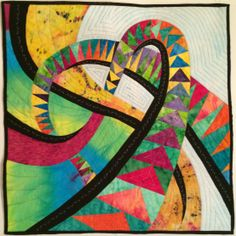 """This quilt is a design from Caryl Breyer Fallert and is called """"Soaring Compliments"""".  A friend taught the class.  The quilting is all my design.  I wanted to learn to piece the curves and the curved flying geese."""