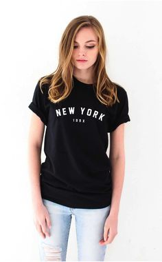 """- Description - Size Guide Details: 'New York 199x' unisex fit graphic tee by NYCT Clothing. 100% Cotton. Made in USA. Sizing: 34"""" / 86.36 cm width 27""""/ 68.58 cm length Model is wearing a size small M"""