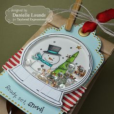 Used the Ready, set, snow and Snow globe images from Taylored Expressions to create this fun shaker tag.