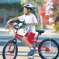 Want a bike that'll stop traffic? First, splatter-paint some stars and add them to your bars -- handlebars, that is -- and to a safety-flag pole. Spiff up your wheels with straws and garlands, then hit the road! (Our decked-out bike should be ridden at a parade pace, not at high speeds.)