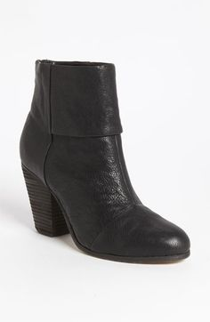 A stacked heel lifts a versatile and ultrachic leather bootie.
