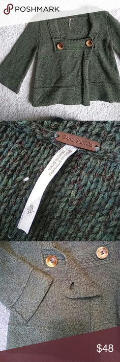 Free People Crop Wool Sweater 2 Real Wooden Buttons close up this adorable forest green crop sweater.   Like new  Perfect for the holidays!!  83% Wool 17% Nylon Free People Sweaters