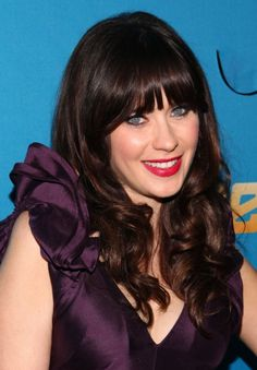 Zooey Deschanel rocks straight bangs and curly hair